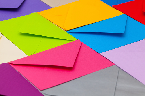 Different colored envelopes on the table.